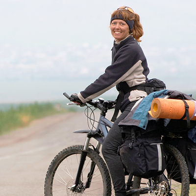 Woman_on_touring_bike_www.yha.co.nz.jpg